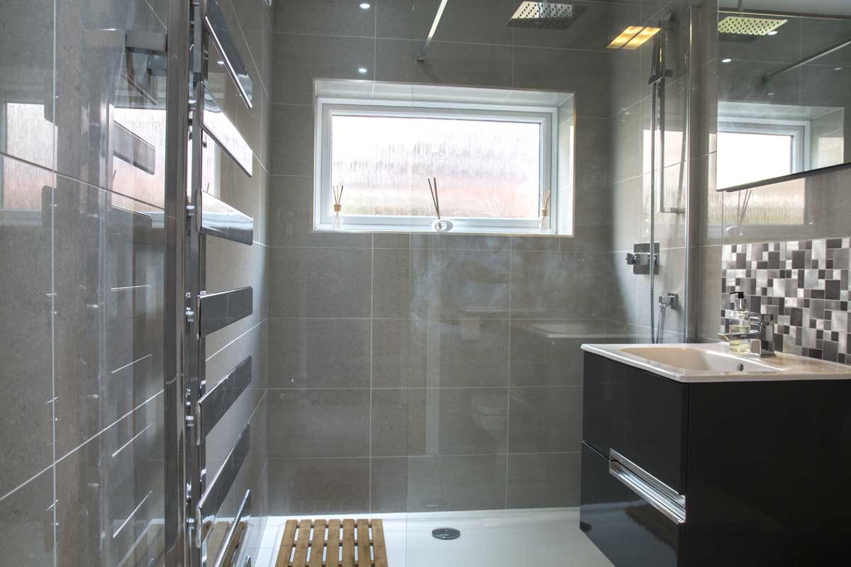 Garage converted into bathroom and utility room by Metrix Contractors in Sussex